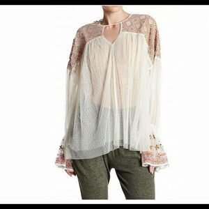 New white Free People embroidered sheer blouse.